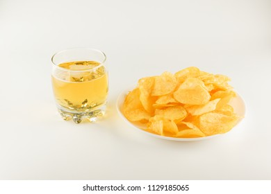 fresh potato chips isolated on a white plate