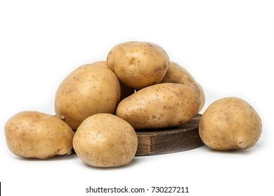 Fresh potato isolated on white background and wooden cutting board