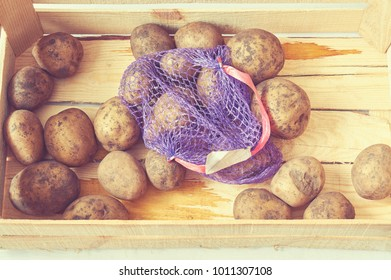 fresh potato in wooden box