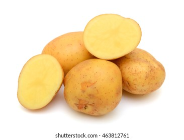Fresh potatoes with half isolated on white background