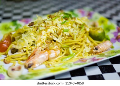 Fresh prepared malaysian Mee Goreng Singapore mixed seafood noodle served in local restaurant on Tioman island. Traditional asian cuisine made of fresh ingredients.