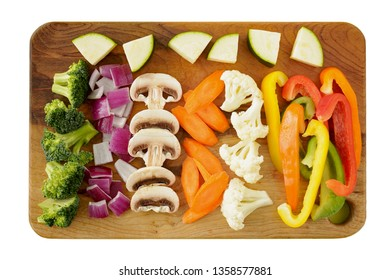 Fresh prepared raw vegetables on wooden cutting board for making a stir fry meal