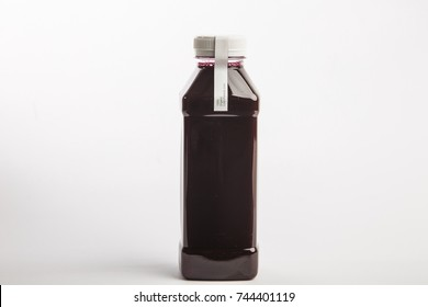 Fresh pressed organic beet juice in big size plastic bottle on the white background. Healthy drink. Detox juice diet