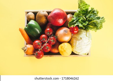 Fresh produce delivery box on yellow background