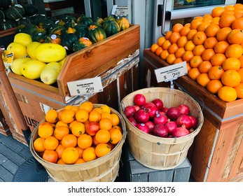 Fresh Produce for Sale at Market Outdoors with Oranges Pomegranate and Squash Melon