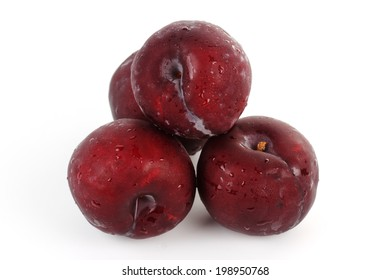 Fresh prune with drops isolated on a white background