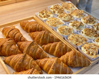 Fresh and puffy croissants and creamy cheese tarts in bakeshop