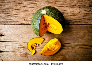 Fresh Pumpkin on Wood Table, Concept and Idea of Food Rustic Style.