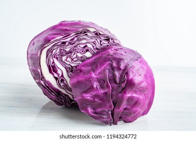Fresh purple cabbage on the kitchen countertop