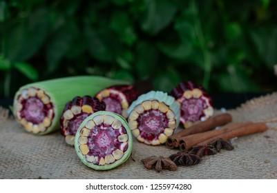 Fresh Purple corn On the black wood table