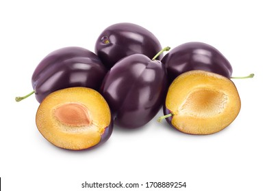 fresh purple plum and half with leaves isolated on white background with clipping path and full depth of field