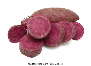 Fresh purple sweet potato with slices isolated on the white background