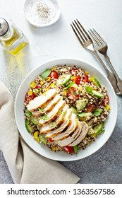 Fresh quinoa tabbouleh salad with grilled chicken, tomatoes and cucumbers, healthy lunch bowl