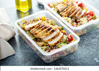 Fresh quinoa tabbouleh salad with grilled chicken and chickpeas, healthy meal prep