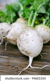 Fresh radishes on the table. Black and white turnips