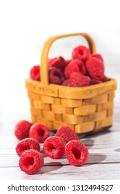 fresh raspberries in a basket close-up as background