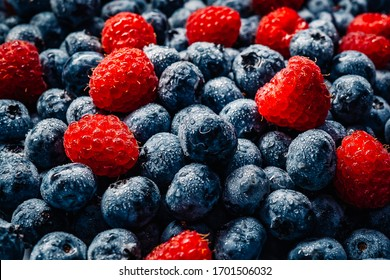 Fresh raspberries and blueberries great bilberry background. Healthy food organic nutrition. Top view from above