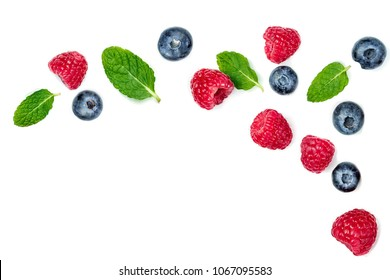 Fresh  raspberries and blueberries with leaves isolated on white background. Berry ornament