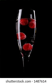 fresh raspberries in a champagne flute