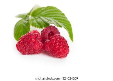 Fresh raspberries with leaf closeup on white background