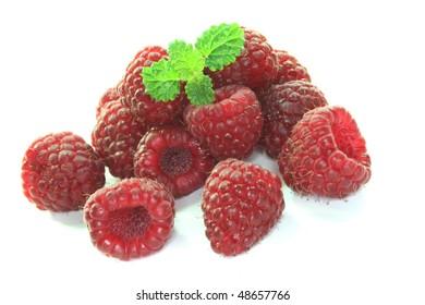 fresh raspberries with a leaf on a white background