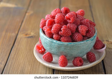 Fresh raspberries on a wooden background