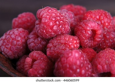 Fresh raspberries on a wooden background.