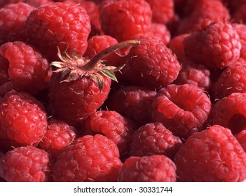 Fresh raspberry with a water drop