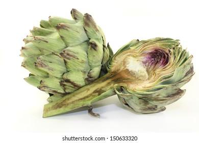 fresh, raw artichoke against a white background