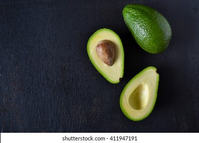 Fresh, raw avocado on a black background
