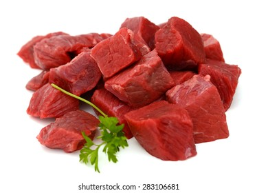 fresh raw beef cubes on white background
