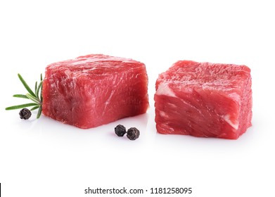 Fresh raw beef cubes pepper and rosemary isolated on white background.
