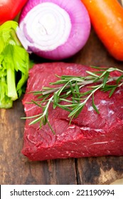 fresh raw beef cut ready to cook with vegetables and herbs