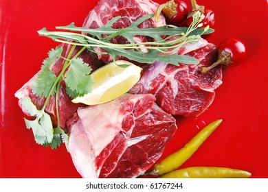 fresh raw beef meat medallion on red plate