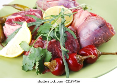 fresh raw beef meat medallion on green plate