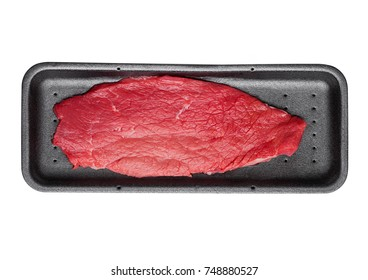 Fresh raw beef steak in black plastic container isolated on white background