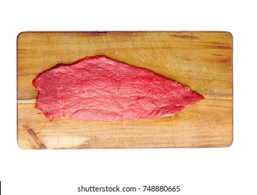 Fresh raw beef steak in black on kitchen wooden board isolated on white background