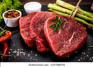 Fresh raw beef steaks on white background