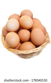 fresh raw brown eggs in a basket.