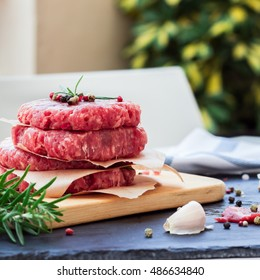Fresh raw burger cutlets, outdoor background