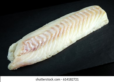 Fresh Raw Cod loin fillet on stone board