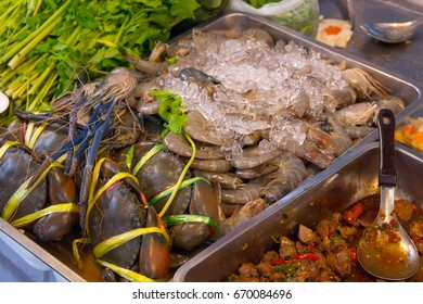 Fresh raw crab and shrimp on market counter. Thai seafood.