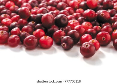 Fresh raw cranberries isolated on white background. closeup