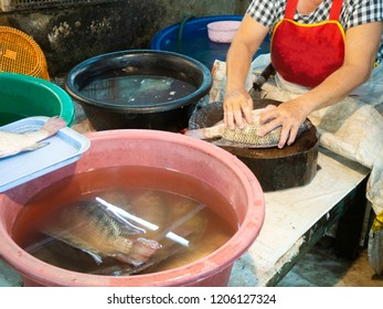 Fresh and raw fish was cut into pieces by the expert fishmonger at the market.