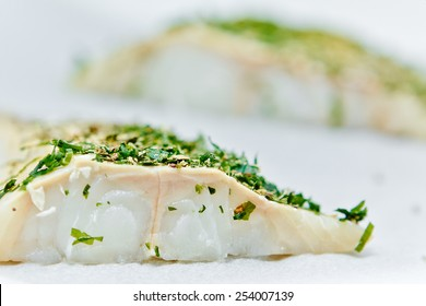 Fresh raw fish filet with herb and spices