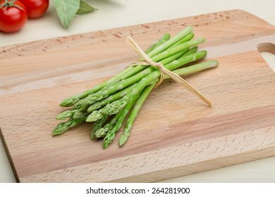 Fresh Raw green asparagus on the wood background