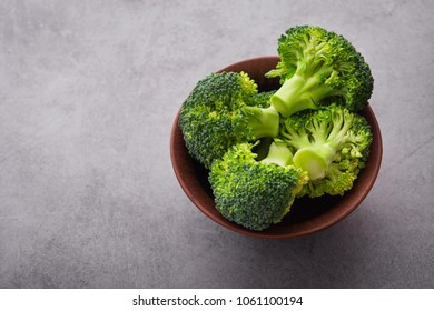Fresh raw green broccoli on a table. Diet healthy product.