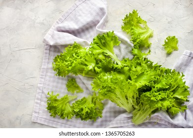 Fresh raw green frillice iceberg lettuce salad on table, top view