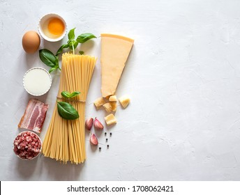 Fresh raw ingredients for traditional italian pasta Carbonara. Top view, copy space