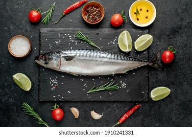 Fresh raw mackerel fish on stone background